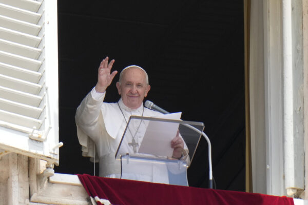 Pope Francis waves to the crowd as he arrives to recite the Angelus noon prayer from the window of his studio overlooking St.Peter's Square, at the Vatican, Sunday, July 4, 2021. (AP Photo/Alessandra Tarantino)