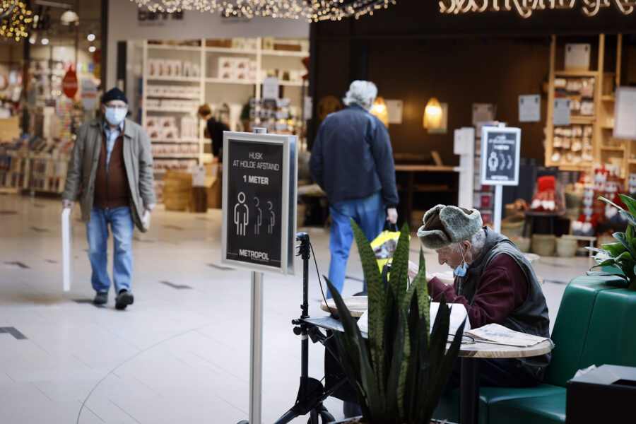 People shop in the Metropole Shopping Center in Hjoering, Denmark, Friday Nov. 6, 2020. More than a quarter million Danes have gone into lockdown in a northern region of the country where a mutated variation of the coronavirus has infected minks being farmed for their fur, leading to an order to kill millions of the animals. Prime Minister Mette Frederiksen said Friday's move was contain the virus, and it came two days after the government ordered the cull of all 15 million minks bred at Denmark's 1,139 mink farms. (Claus Bjoern Larsen/Ritzau Scanpix via AP)