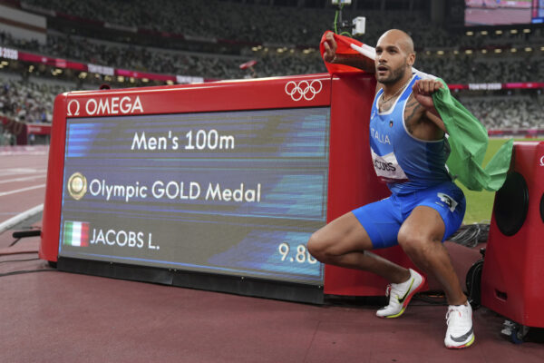 Lamont Marcell Jacobs, of Italy, celebrates after winning the final of the men's 100-meters at the 2020 Summer Olympics, Sunday, Aug. 1, 2021, in Tokyo. (AP Photo/Matthias Schrader)