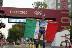 Antonella Palmisano of Italy holds the Italian flag after winning in the women's 20km race walk at the 2020 Summer Olympics, Friday, Aug. 6, 2021, in Sapporo, Japan. (AP Photo/Shuji Kajiyama)