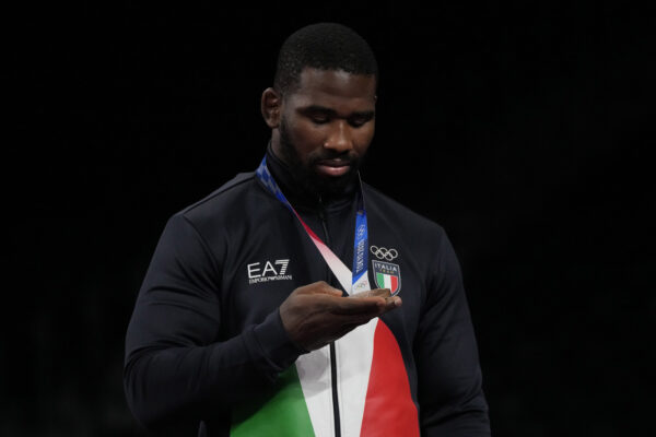 Abraham de Jesus Conyedo Ruano inspects his bronze medal during the victory ceremony for men's freestyle 97kg wrestling at the 2020 Summer Olympics, Saturday, Aug. 7, 2021, in Chiba, Japan. (AP Photo/Aaron Favila)