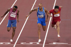 Bingtian Su, of China, right, races to win a semifinal of the men's 100-meters ahead of Ronnie Baker, of United States, left, and Lamont Jacobs, of Italy, at the 2020 Summer Olympics, Sunday, Aug. 1, 2021, in Tokyo, Japan. (AP Photo/Charlie Riedel)