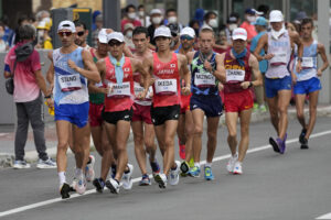 Massimo Stano, of Italy, leads a group during the men's 20km race walk at the 2020 Summer Olympics, Thursday, Aug. 5, 2021, in Sapporo, Japan. (AP Photo/Eugene Hoshiko)
