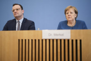 German Chancellor Angela Merkel, right, and Health Minister Jens Spahn attend a news conference about the coronavirus outbreak in Germany, in Berlin, Germany, Wednesday, March 11, 2020. For most people, the new coronavirus causes only mild or moderate symptoms, such as fever and cough. For some, especially older adults and people with existing health problems, it can cause more severe illness, including pneumonia. (AP Photo/Markus Schreiber)