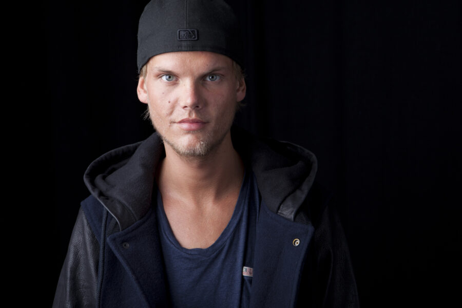 FILE – Swedish DJ, remixer and record producer Avicii poses for a portrait, in New York on Aug. 30, 2013. The indoor arena in Stockholm, which first opened in 1989, is being renamed AVICII ARENA. Avicii, born Tim Bergling, died at age 28 in 2018 by suicide. (Photo by Amy Sussman/Invision/AP, File)