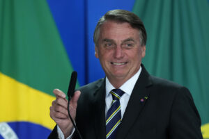 Brazil's President Jair Bolsonaro speaks at a ceremony at the Planalto presidential palace, in Brasilia, Brazil, Wednesday, Oct. 20, 2021. A Senate report recommended Wednesday pursuing crimes against humanity and other charges against Bolsonaro for allegedly bungling Brazil's response to COVID-19 and contributing to the country having the world's second-highest pandemic death toll. (AP Photo/Eraldo Peres)